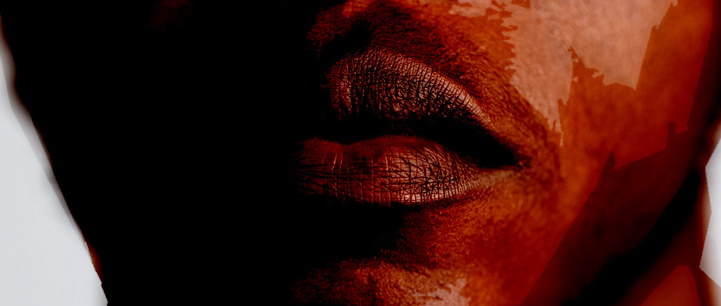 Close image of a mans closed mouth.