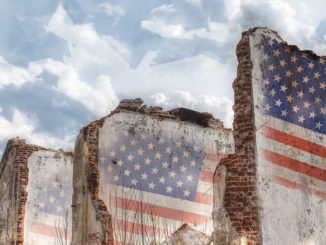 American flag on broken walls.